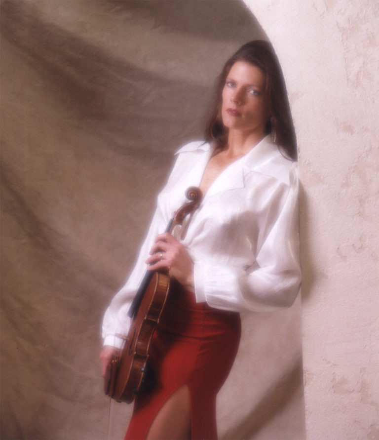 Lynnette Thredgold holding violin